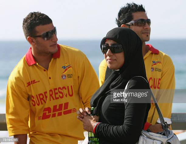 Mecca Laa Laa talks to other lifesavers before changing into a 'Burqini' before her first surf lifesaving patrol at North Cronulla Beach February 4,...