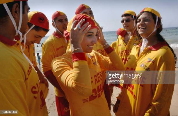 Mecca Laalaa a Surf Life Saver volunteer lifeguard center adjusts her burqini as other Surf Life Savers look on at North Cronulla beach in Sydney...