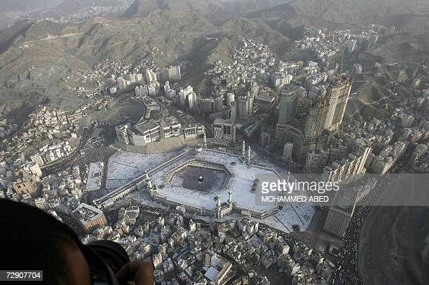 A photographer takes pictures from the air of the Kaaba at the Grand Mosque in the Saudi holy city of Mecca on the second day of Eid alAdha 31...
