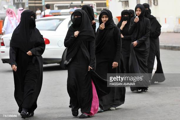 Muslim women cross a street in the holy city of Mecca in Saudi Arabia where Palestinian Authority president Mahmud Abbas and Hamas supremo Khaled...
