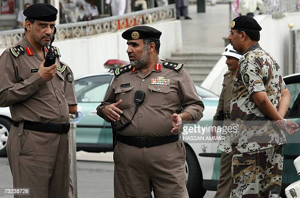 Saudi policemen secure the main square in the holy city of Mecca in Saudi Arabia where Palestinian Authority president Mahmud Abbas and Hamas supremo...