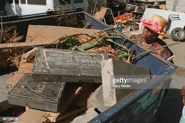MECemetery#2pr8–15C Janet Babers Compton inspects grave stones in a dumpster in a storage area of Lincoln Memorial Park Cemetery She was taking notes...