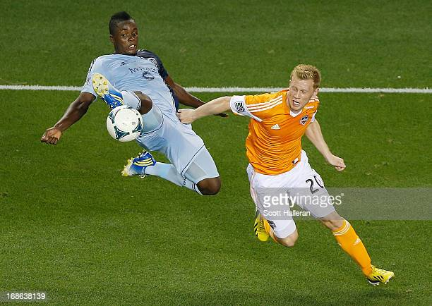 Mechack Jerome of Sporting Kansas City fights for the ball against Andrew Driver of the Houston Dynamo in the second half at BBVA Compass Stadium on...