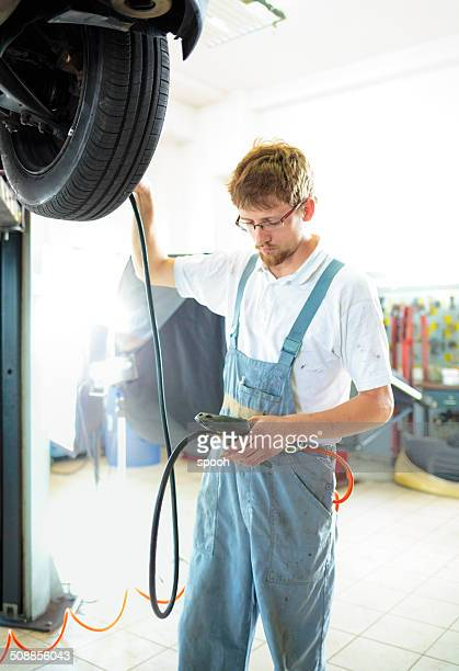 Mechanic adjusting pressure
