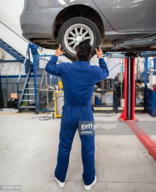 Mechanic changing a flat tire