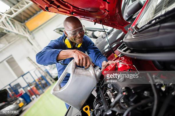 Mechanic changing oil