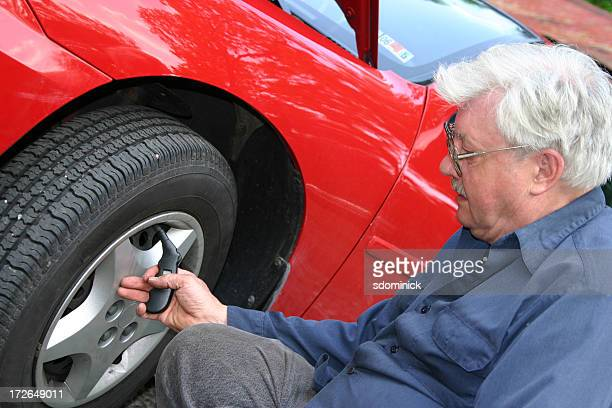 Mechanic: Checking Tire Pressure
