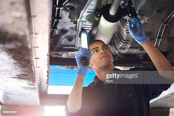 Mechanic checks exhaust