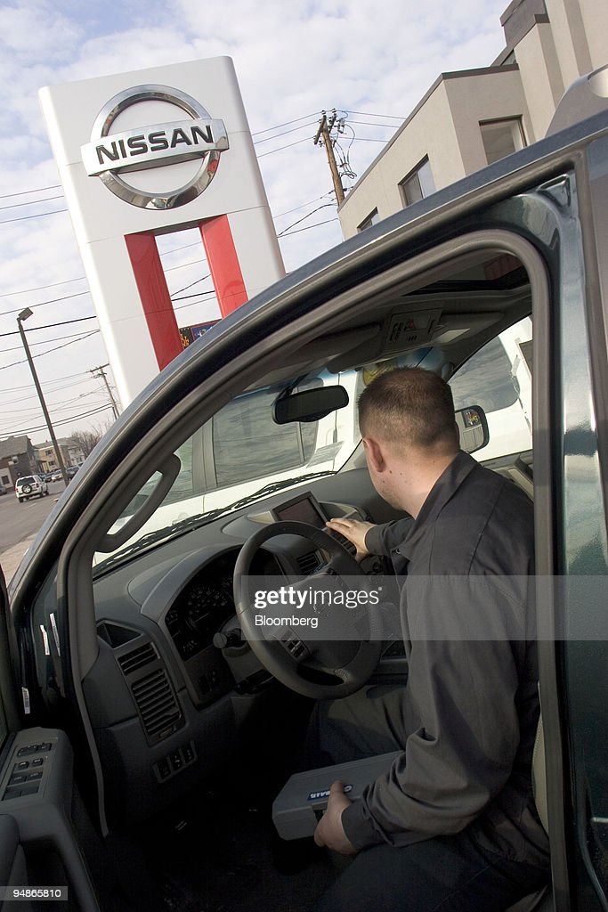 A Mechanic Checks Over A New Car At Colonial Nissan In Medfo