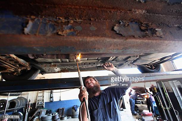 Mechanic Chucky Oliver welds a pipe at his auto repair shop in Owsley County on April 19 2012 in Booneville Kentucky Daniel Boone once camped in the...