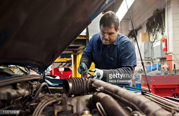 Mechanic fixes engine