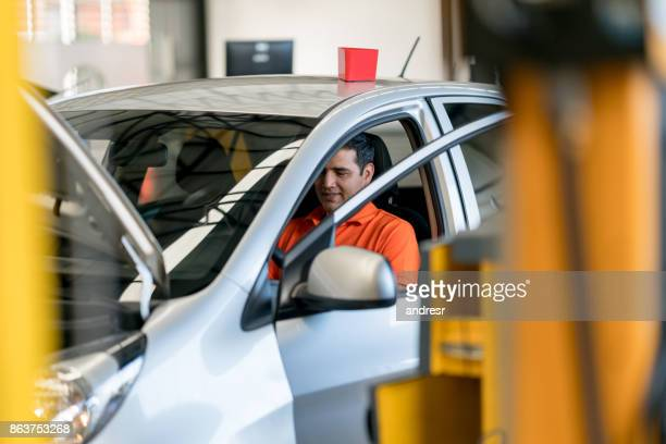 mechanic fixing a car at a garage - test drive stock pictures, royalty-free photos & images