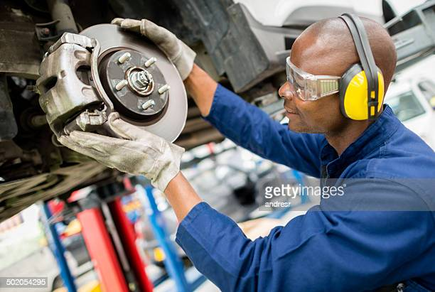 Mechanic fixing a car