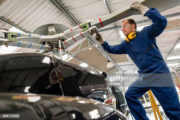 Mechanic fixing a helicopter