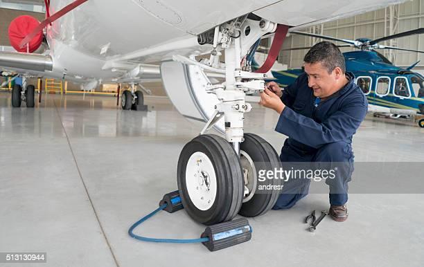 Mechanic fixing an airplane