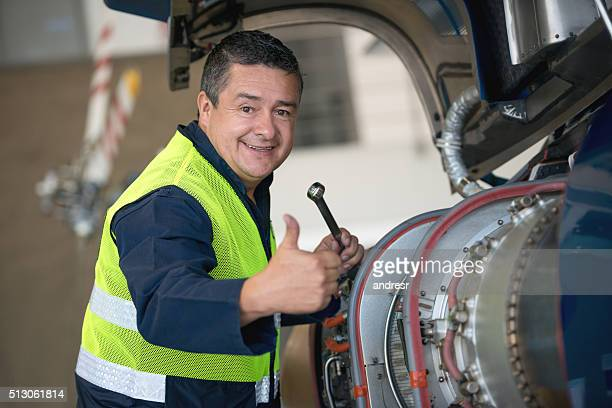 Mechanic fixing the engine of a helicopter