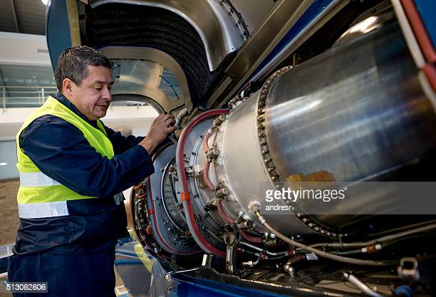 Mechanic fixing the engine of an airplane