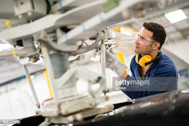 mechanic fixing the propeller - aircraft stock photos and pictures