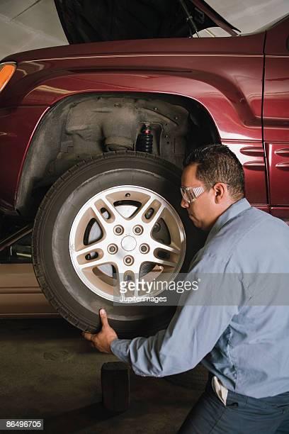 Mechanic fixing tire