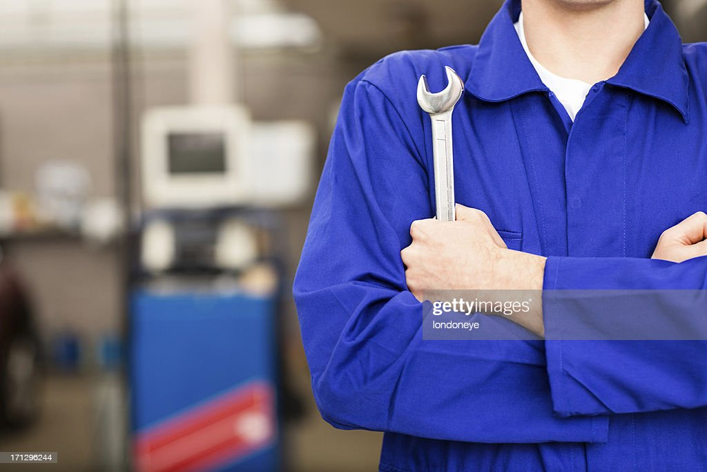 Mechanic Holding Wrench : Stock Photo