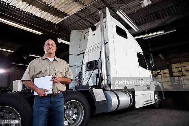 mechanic in garage with semi-truck - trucking stock pictures, royalty-free photos & images