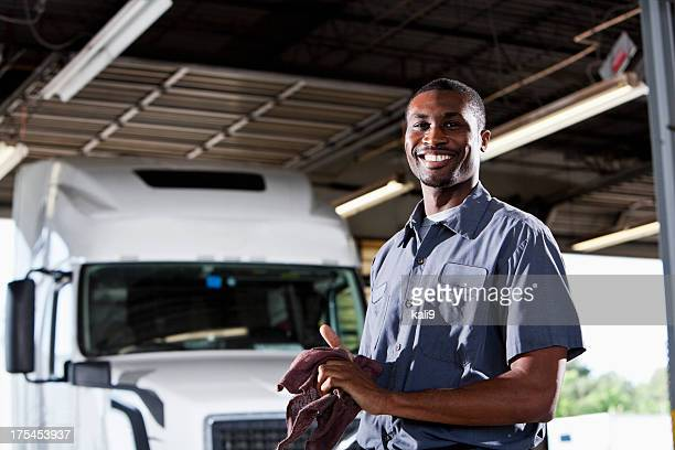 mechanic in garage with semi-truck - mechanic stock pictures, royalty-free photos & images