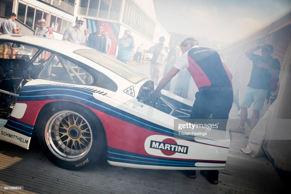 A mechanic inspects a classic Porsche racing car during the Goodwood Festival Of Speed at Goodwood on July 12, 2018 in Chichester, England.