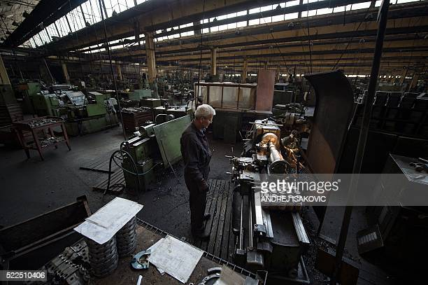 A mechanic monitors a machine at a truck factory in western Serbian town of Priboj on April 14 2016 Deep in a western Serbian valley the town of...