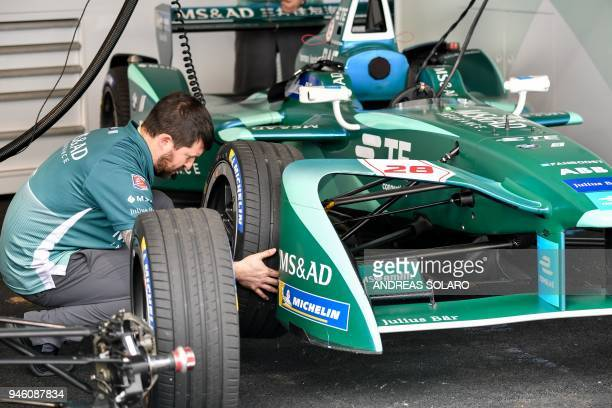 A mechanic of the MS AD Andretti team works on an electric race car in the pit before the start of the Rome leg of the Formula E electric car...
