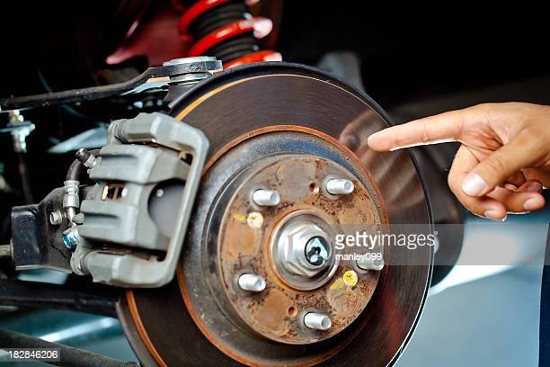 mechanic pointing at brake rotor