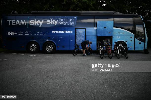Mechanic prepares the bicycles of Team Sky cycling team prior to a training session on July 4, 2018 in Saint-Mars-la-Reorthe, western France, three...