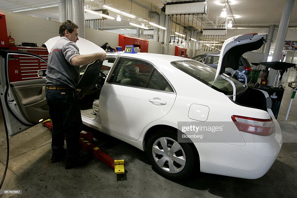 A Mechanic Prepares To Make A Repair On A Gas Pedal On A 2009 Toyota Camry