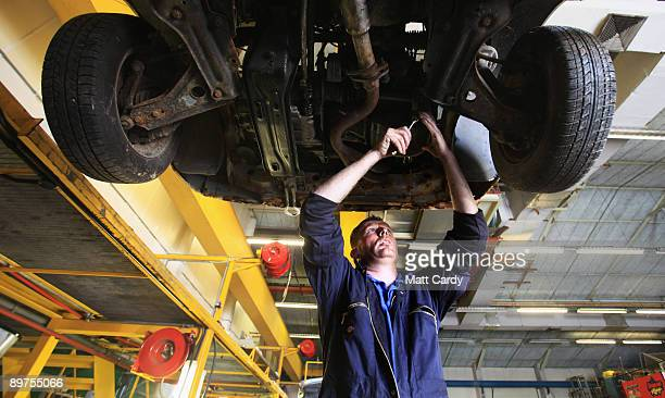 A mechanic processes a car that has been brought in for dismantling and recycling at CMS Vehicle Solutions Ltd on August 11 2009 in Gloucester...