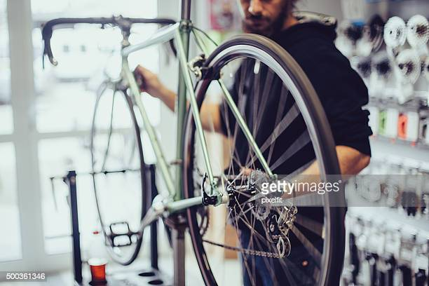 Mechanic repairing a bike
