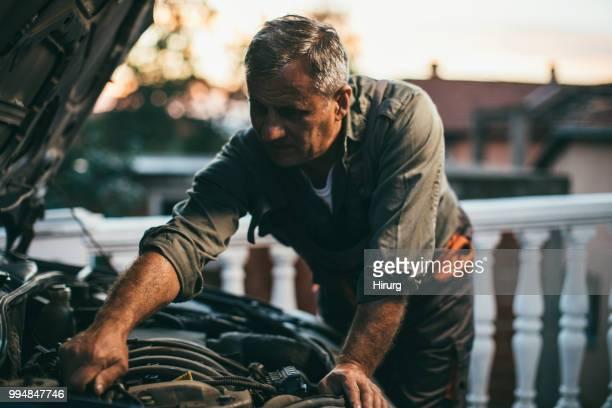 mechanic repairing car - car repair stock pictures, royalty-free photos & images