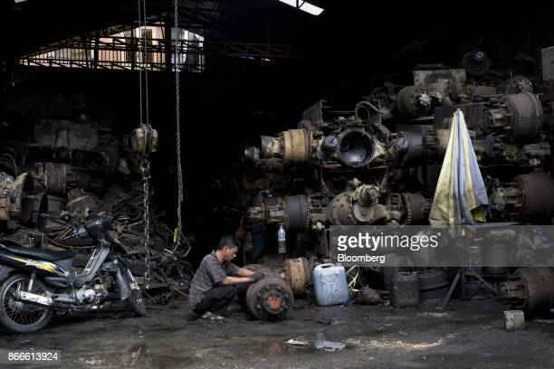 A mechanic repairs a truck axle at a workshop in Phnom Penh Cambodia on Tuesday Oct 24 2017 The International Monetary Fund projects that Cambodias...