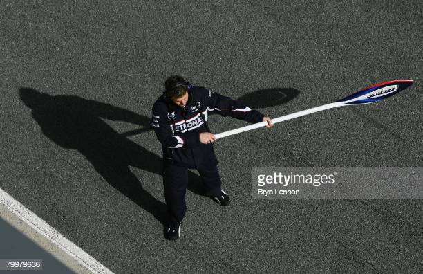 BMW mechanic signals for his driver to stop during Formua One Testing at the Circuito de Jerez on February 12 2008 in Jerez Spain