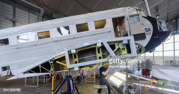 Mechanic Sven Richter working on the Junker Ju 52 in a hall on the grounds of LufthansaTechnik in Hamburg Germany 6 April 2016 The plane is currently...