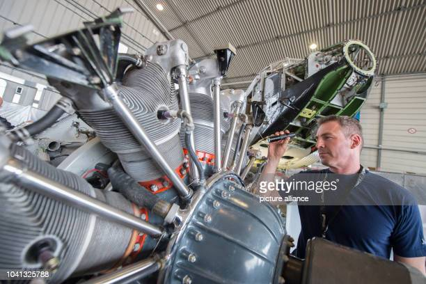 Mechanic Sven Richter working on the motor of the Junker Ju 52 in a hall on the grounds of LufthansaTechnik in Hamburg Germany 6 April 2016 The plane...