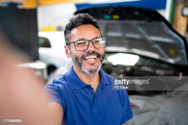 mechanic taking a selfie in auto repair shop - part of stock pictures, royalty-free photos & images