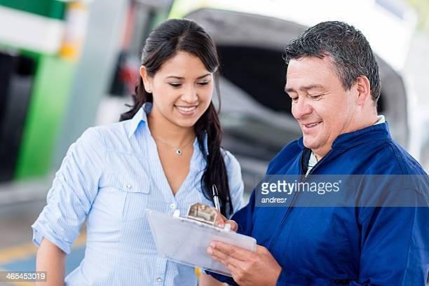 Mechanic talking to customer