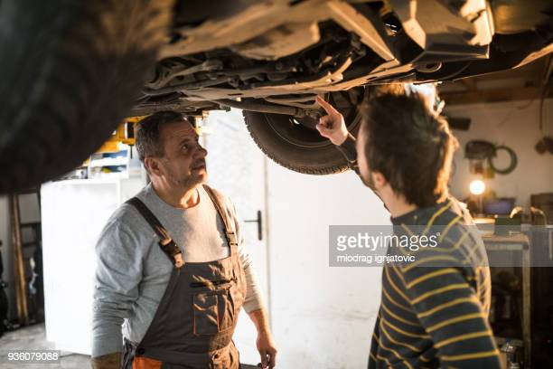Mechanic talking to the car owner
