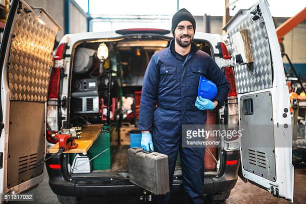 mechanic technician on a garage - arbeider stockfoto's en -beelden