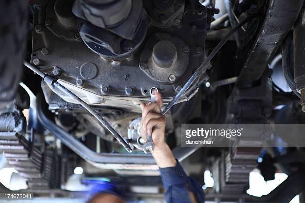 Mechanic under a truck