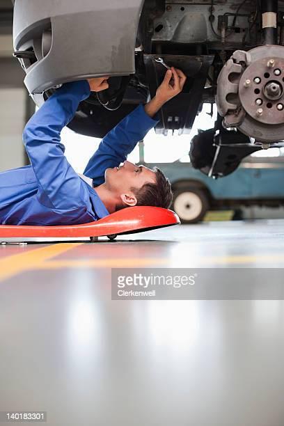 Mechanic underneath car