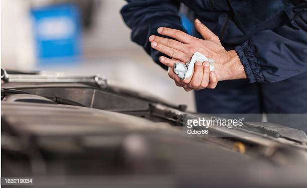 Mechanic wiping his hands clean