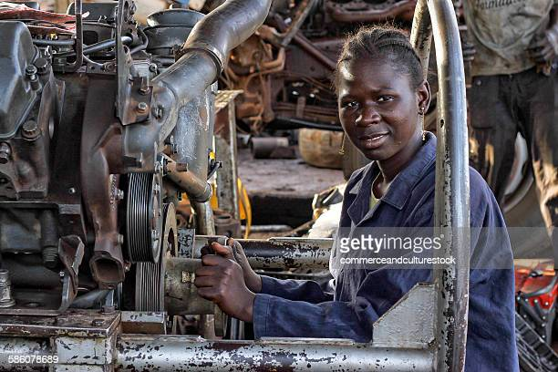 A mechanic woman in a factory