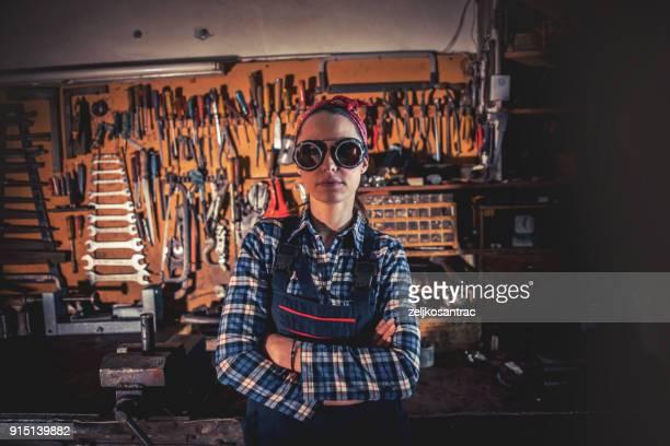 Mechanic woman in workshop