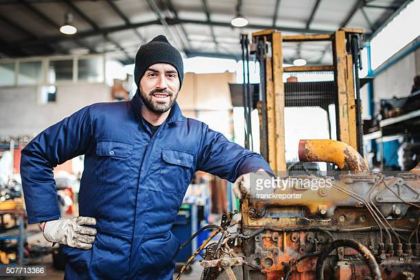 mechanic working in a workshop on a truck engine