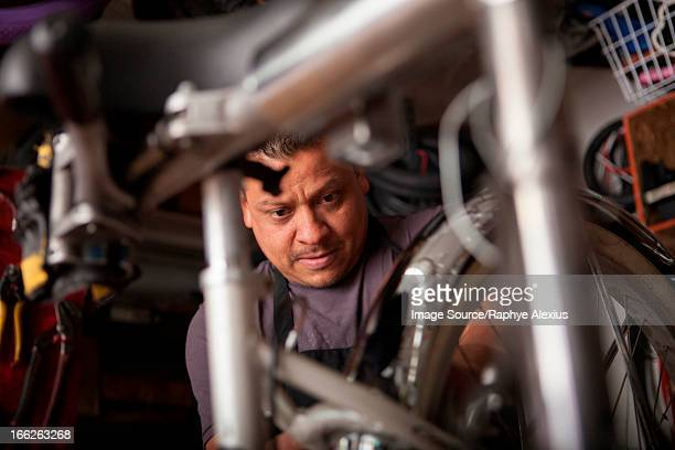 Mechanic working in bicycle shop